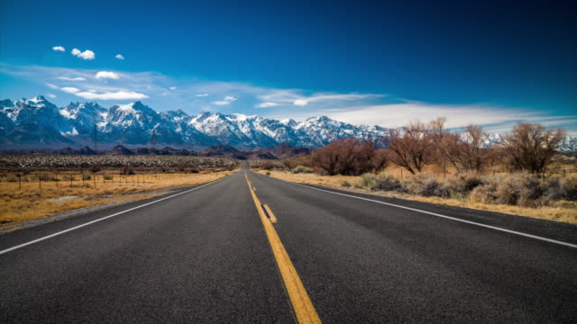 empty road in beautiful landscape - tracking shot - long stock videos & royalty-free footage