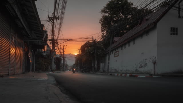 empty road with background of sunset in chiang mai thailand during covid-19 coronavirus pandemic - empty road stock videos & royalty-free footage