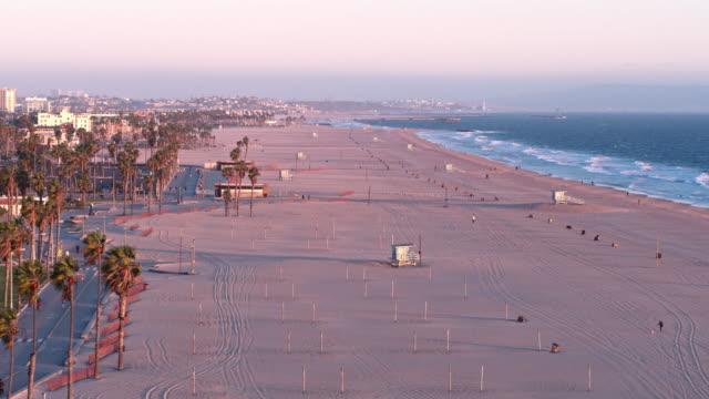 empty santa monica beach during covid-19 pandemic - beach stock videos & royalty-free footage