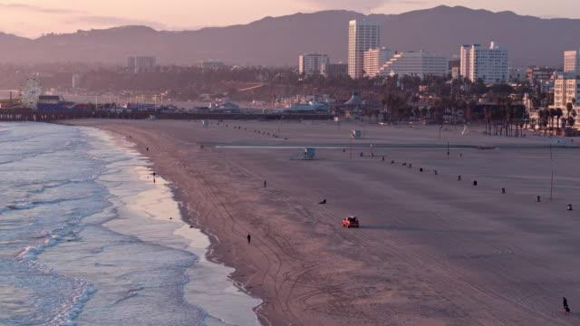 empty santa monica beach during covid-19 pandemic - dutcheraerials covid stock videos & royalty-free footage