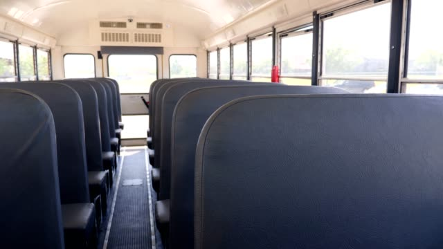 vídeos de stock e filmes b-roll de empty school bus seats - transportation