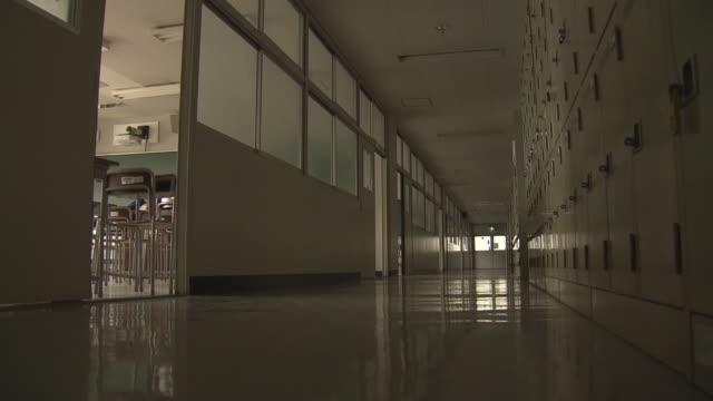 empty school corridor and classroom, tokyo, japan - directional sign stock videos & royalty-free footage