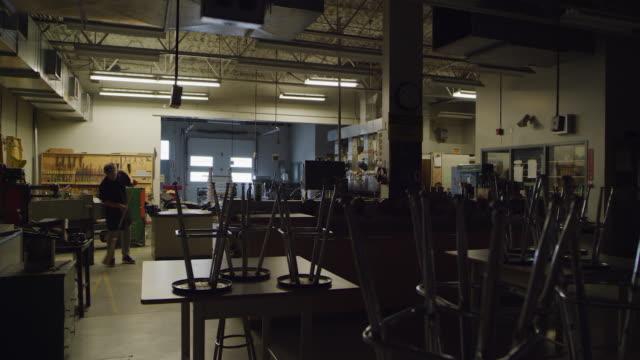empty school metal shop - sweeping stock videos & royalty-free footage