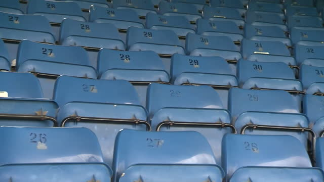 empty seats at cambridge united's abbey stadium football ground, as they prepare to welcome fans back for the first time since the coronavirus... - furniture stock videos & royalty-free footage