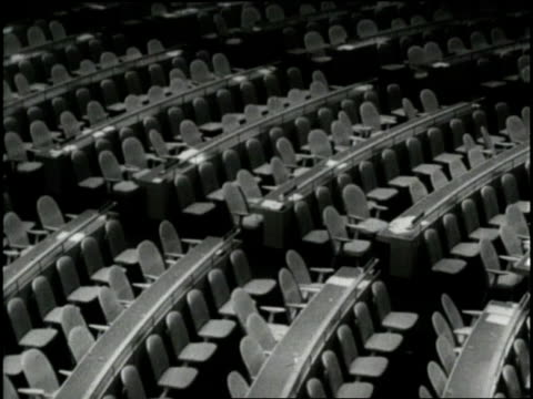 empty seats fill the general assembly auditorium in the united nations. - vereinte nationen stock-videos und b-roll-filmmaterial