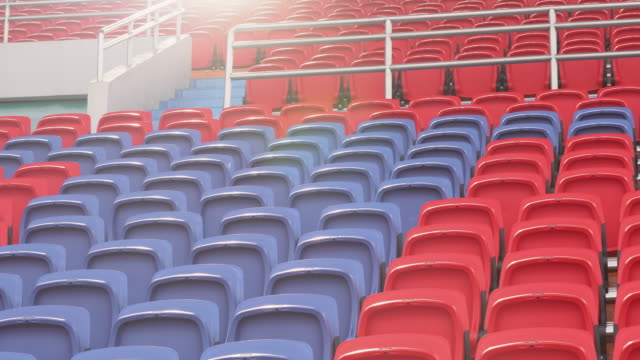 empty seats in a stadium - stabilimento sportivo video stock e b–roll