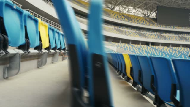 vídeos y material grabado en eventos de stock de empty seats in a stadium - asiento