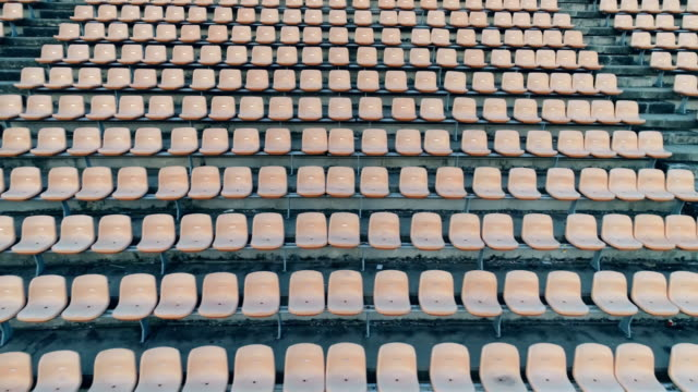 empty seats in a stadium - tribuna video stock e b–roll
