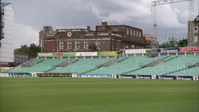 empty seats line the stands at the oval cricket ground. available in hd. - oval kennington stock videos & royalty-free footage