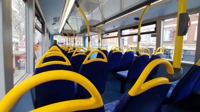 empty seats on a bus in south east london during the coronavirus pandemic on march 20, 2020 in london, england - brian dayle coronavirus stock videos & royalty-free footage