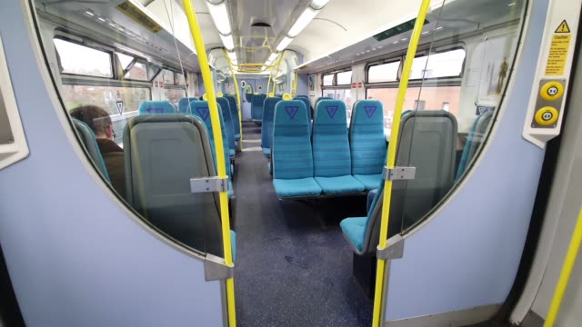 empty seats on a train during rush hour into london bridge train station during the coronavirus pandemic on march 18 2020 in london england - brian dayle coronavirus stock videos & royalty-free footage
