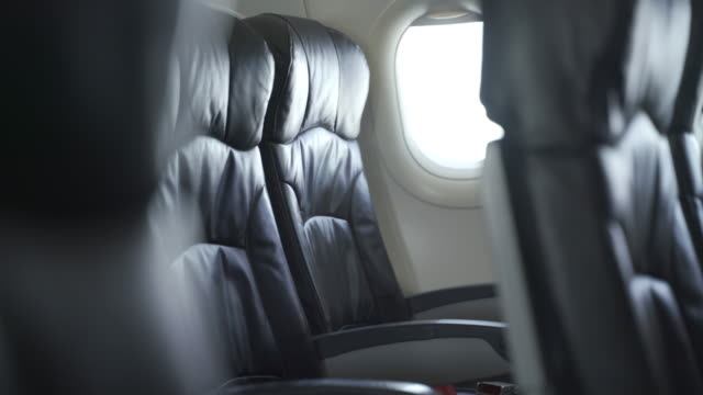 empty seats on the passenger plane was canceled during coronavirus epidemic - leather stock videos & royalty-free footage