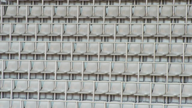 td empty seats on the tribune at the stadium - seat stock videos & royalty-free footage