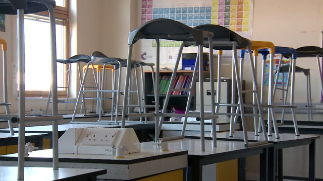 empty secondary school classroom due to coronavirus pandemic lockdown - classroom stock videos & royalty-free footage