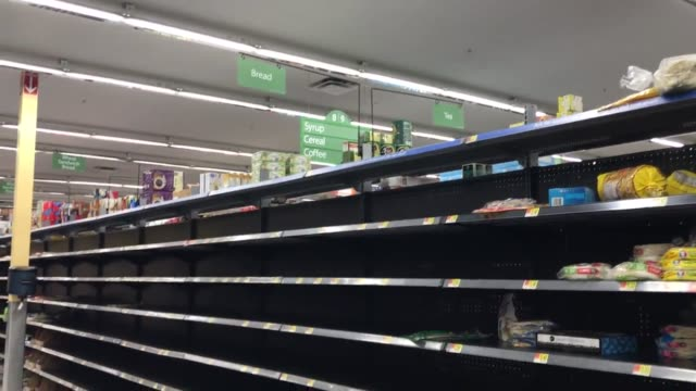 empty shelves found all through out the neighborhood walmart as people prepare for irma - shelf stock videos & royalty-free footage