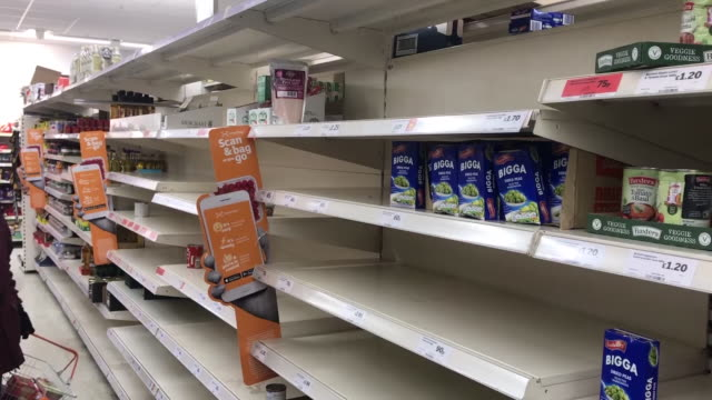 empty shelves in london supermarket, people buying up disinfectant products - shelf stock videos & royalty-free footage