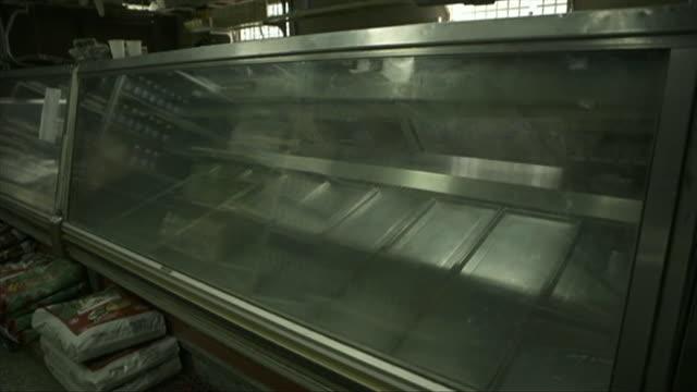 empty shelves in supermarket in caracas venezuela - shelf stock videos & royalty-free footage