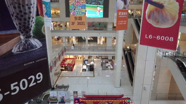 empty shopping mall on the famous business street of binjiang dao at downtown tianjin wuhan new coronavirus pneumonia has been spread around all... - chinese culture stock videos & royalty-free footage