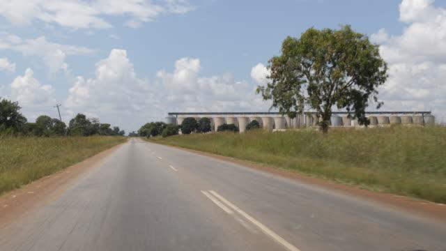 empty silos around chinhoyi in zimbabwe - repubblica dello zimbabwe video stock e b–roll