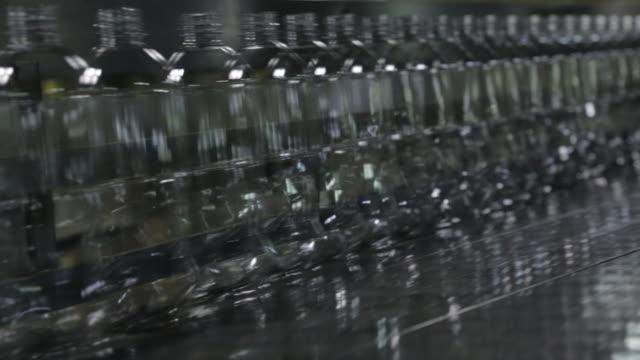 MS Empty soda beverage bottles on bottling line / soda and beverage manufacturing
