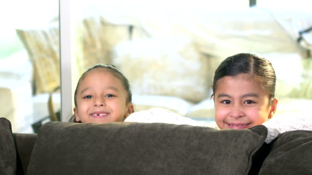 empty sofa, two hispanic girls pop up to show faces - 6 7 years stock videos & royalty-free footage