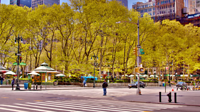 empty spring bryant park after pandemic. 42nd street. symbol of reopening economy - bryant park stock videos & royalty-free footage