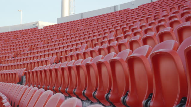 empty stadium seats awaiting the spectators. - social distancing stock videos & royalty-free footage