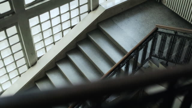 empty staircase in university building, view from below - staircase stock videos & royalty-free footage
