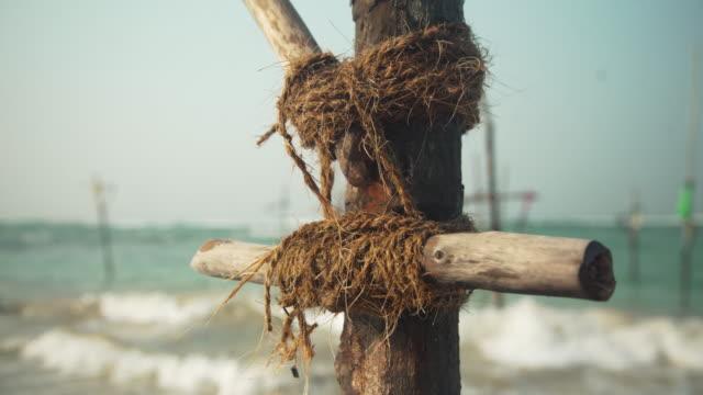 Empty stick crucifix for stilt fishing at Sri Lanka. Iconic image