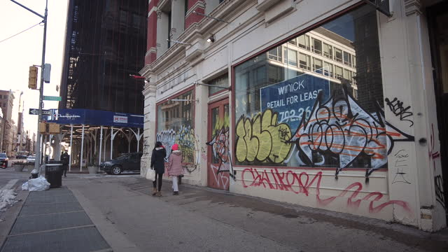 """empty storefront covered with graffiti on broadway in nyc soho manhattan during the coronavirus pandemic . """"retail for lease"""" sign. video: thompics -... - broadway manhattan stock videos & royalty-free footage"""