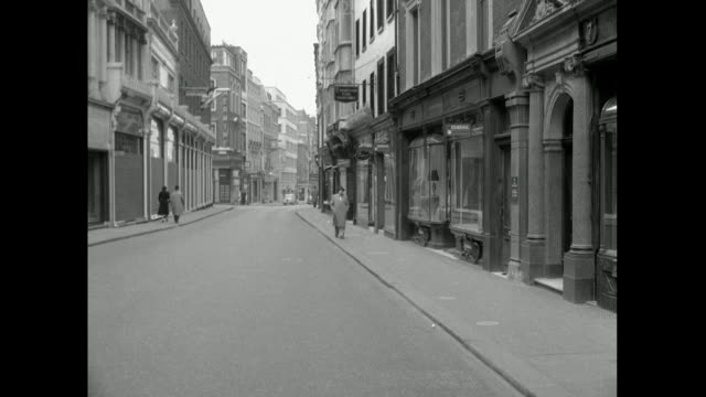 empty street in london with one man walking; 1957 - 1950 stock videos & royalty-free footage