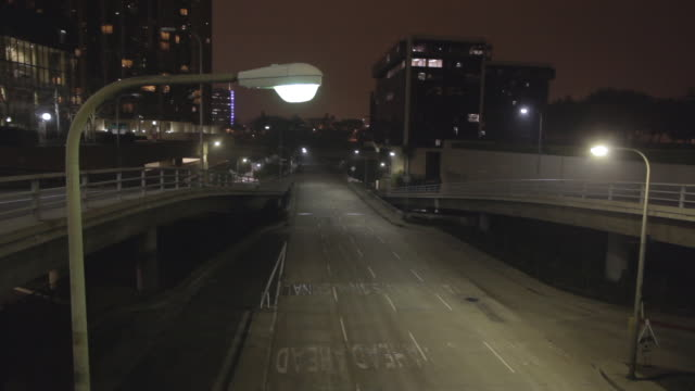 empty street in los angeles (for boston) surveillance camera pov, night - street light stock videos & royalty-free footage