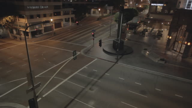 empty street in los angeles (for omaha) surveillance camera pov, night - urban road stock videos & royalty-free footage