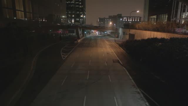 empty street in los angeles surveillance camera pov, night - empty road stock videos & royalty-free footage