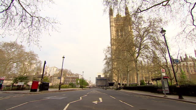 empty street scenes in westminster around the houses of parliament during lockdown due to the coronavirus crisis - capital cities stock videos & royalty-free footage