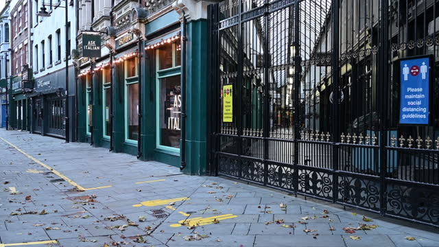 empty streets and a closed wyndham arcade on october 27, 2020 in cardiff, wales. wales entered a national lockdown on friday evening which will... - high street stock videos & royalty-free footage