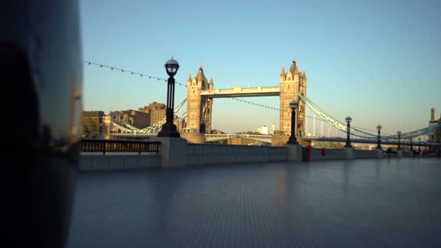empty streets around tower bridge in london - tower bridge stock videos & royalty-free footage