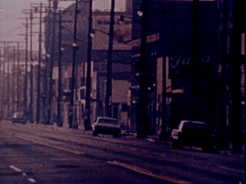 vídeos de stock, filmes e b-roll de empty streets during early morning los angeles police raid of a black panther party stronghold just days after the notorious melee in chicago that... - cube