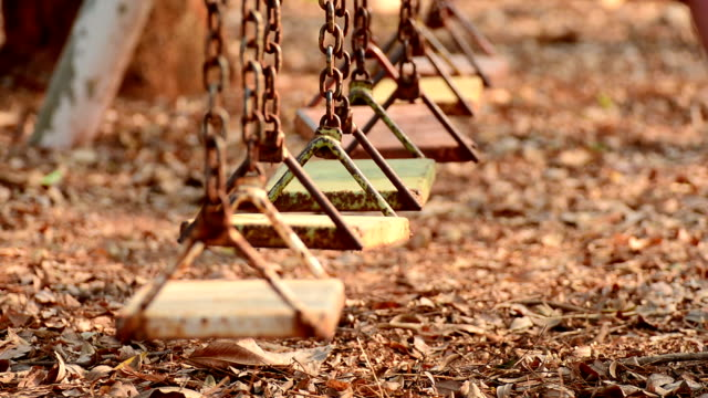 empty swing in a sunlight - playground stock videos & royalty-free footage