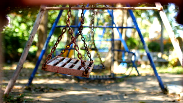 empty swing in park - group of objects stock videos & royalty-free footage