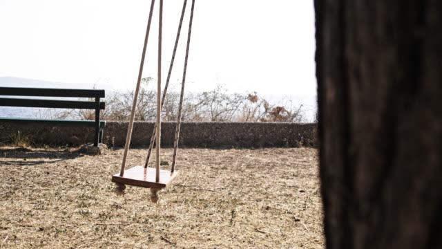 slo mo empty swing on the coast - digital enhancement stock videos & royalty-free footage