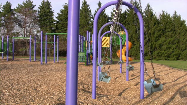 empty swings in a playground - playground stock videos & royalty-free footage