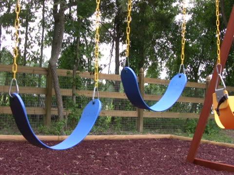 stockvideo's en b-roll-footage met empty swings on a playground 2 ntsc - kleine groep dingen