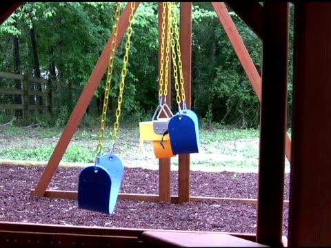 stockvideo's en b-roll-footage met empty swings on a playground 3 ntsc - kleine groep dingen