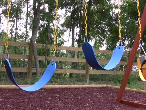 empty swings on a playground 4 pal - small group of objects stock videos & royalty-free footage