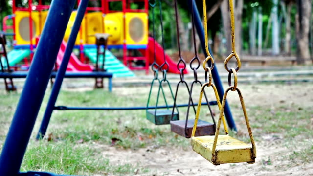 empty swings swaying at playground - mourner stock videos and b-roll footage