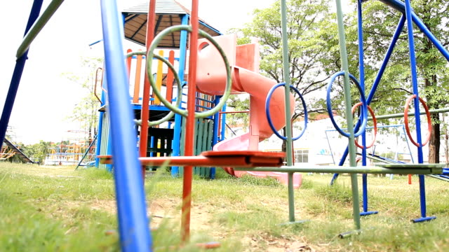empty swings swaying at playground - mourning stock videos and b-roll footage