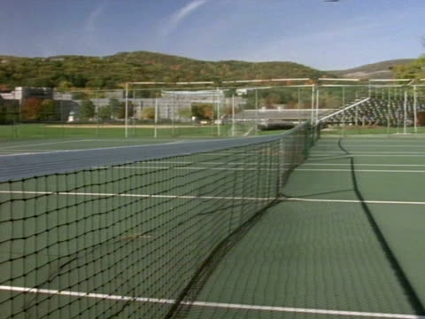 Empty tennis courts from net w/ Cadet Chapel BG at United States Military Academy