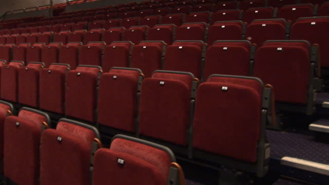 empty theatre seats 1 - hd & pal - auditorium stock videos and b-roll footage