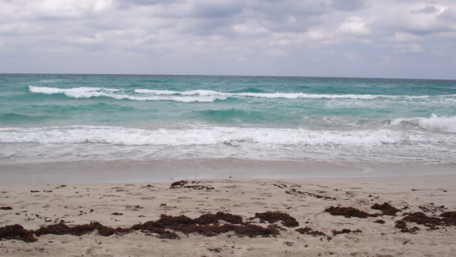 empty varadero beach in a bad weather day. uncomfortable waves and wind make swimming dangerous in the tourist destination - varadero stock videos and b-roll footage